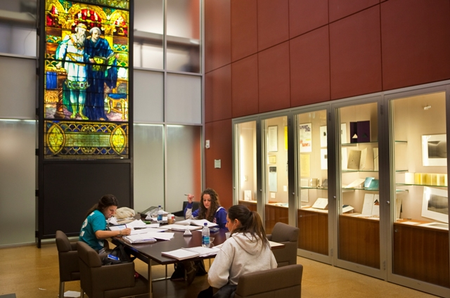 Students studying in Simon Room, Skillman Library with Tiffany window in background